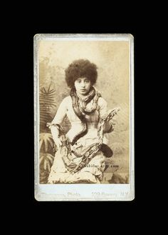 Rare CDV of Woman with Afro Holding a Python Taken by the famous sideshow and celebrity photographer Charlese Eisenmann.
