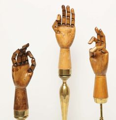 Wooden Articulating Glove Displays With Brass Mounts