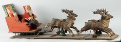 "Rare ""Schoenhut "" Santa Claus and Sleigh with 4 Reindeers. A rare toy. It is in the 1914 Schoenhut catalog. Santa is fully jointed. The four hand-carved reindeer rest and pivot on two pedestals on the platform. Very few made,as they were expensive when made in 1914. They were Store Display Items. The sleigh on this item is not original."