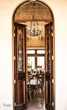 Antique french door frame the entrance to this beautiful lodge and provides a peek at the antique chandelier and beautiful travertine floors. Antique French Doors, French Antiques, Elope Wedding, Destination Wedding, Travertine Floors, Luxury Wedding Venues, Antique Chandelier, Beautiful Landscapes, Real Weddings