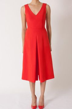 This burnt rose midi dress features layered pleats that border the front slit on-seam pockets and hidden back zip on this V-neck dress.   Klara Red Dress by Black Halo. Clothing - Dresses - Cocktail Clothing - Dresses - Midi Back Bay Boston Massachusetts
