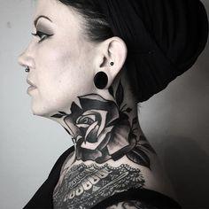 Black rose on neck by Ela Pour
