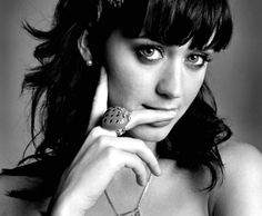 Katy Perry is pretty, even though sometimes she dresses quite scandalous!  Her face remind me of Zooey Deschanel, also pretty!!