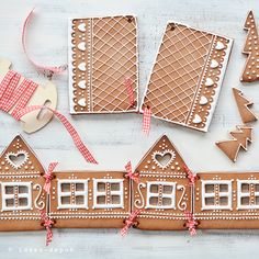 What a wonderful idea! No more playing with the caramel or royal icing, just pretty ribbons and the house will stay up!