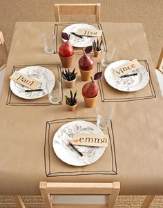 AWESOME KIDS' TABLE IDEA - So many ways to tailor this for all occasions...  Cover their table in kraft paper with pots or cups of crayons.  Frame their place setting and stamp or handwrite name tags.  Keep them entertained and everyone has a great dinner party!
