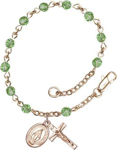14kt Gold Filled Rosary Bracelet features 4mm Peridot Swarovski beads. The Crucifix measures 1/2 x 1/4. Each Rosary Bracelet is presented in a deluxe velvet gif