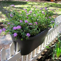 Flower Bridge Planter - designed to be placed over a balcony, picket fence, chain-link fence, or old-fashioned wrought iron railing. The planters include spacers, which are used to hang the planters straight, and prevent the pot from moving around. Available in taupe or terra cotta or white.