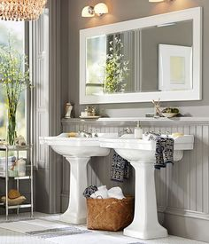 Towels with texture and prints add a delightful touch to an otherwise neutral bathroom.