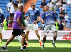Real Madrid's Portuguese forward Cristiano Ronaldo controls a ball next to Real Madrid's Welsh forward Gareth Bale before the Spanish league football...