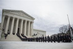 The casket of Supreme Court Justice Antonin Scalia arrives at the Supreme Court in Washington, Friday, Feb. 19, 2016. Thousands of mourners will pay their respects Friday for Justice Antonin Scalia as his casket rests in the Great Hall of the Supreme Court, where he spent nearly three decades as one of its most influential members. (AP Photo/Evan Vucci)