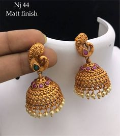 Nj 44 Price:650delivery charges## Whats app 8328546069 for orders#templejewellery ##teluguwedding ##guutupusaluNew ####waistbelt ##vanki ##bridaljewelry ##chokers ##chennai ##neckset ##Payal ##telugubride ##sarees ##grandjewellery ##jhumkas ##Mattie ##diamonds ##hairclip ##lakshmifashianawhatsappc ##pellipoolajada ##makeuptutorial ##Earrings ##templejewellery ##weddings## jewellary##chokers##bangles ##Bangalore ##chennai ##Mumbai ##kerala ##kada ##bridaljewelry ##manufacturers ##madhurai… Gold Jhumka Earrings, Indian Jewelry Earrings, Jewelry Design Earrings, Gold Earrings Designs, Necklace Designs, Etsy Earrings, Jhumka Designs, Gold Necklace, 1 Gram Gold Jewellery