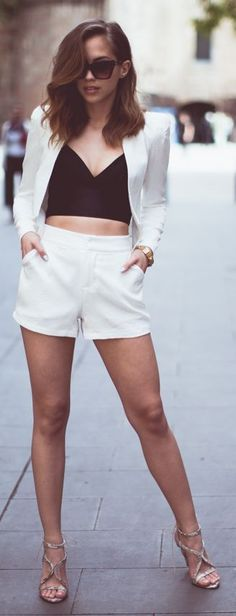 White high-waisted shorts, black crop top, and a crisp white cropped blazer. Summer chic.
