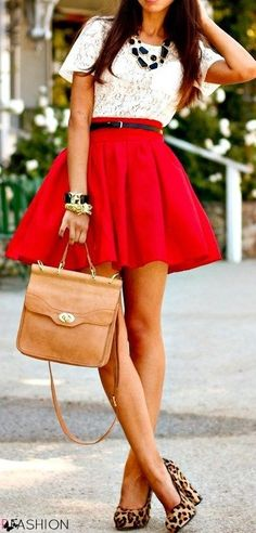 White lace top and a red skirt, paired with black accents, leo and a brown leather bag