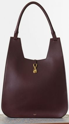 Celine-Hobo-with-Hook-Handbag-in-Burgundy-Smooth-Calfskin Color: Burgundy Size: 13′ x 17′ x 4′ inches Price: €1700 euro'