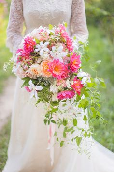 Cascading bridal bouquet with dahlias, garden roses and clematis. By Cincinnati wedding florist Floral Verde. Image by Magic Memory Works.