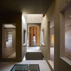 House in Kokubunji by Suppose Design Office:  Wooden house punched throughout with holes.