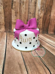 White with black polka dots pink bow cake. Girl Kate spade