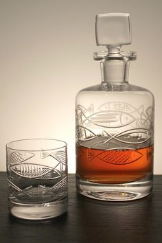Inspired by mid-century designs utilizing stylized etched fish, our new Go fish glassware is bold and charming. While there may be plenty of fish in the sea, this finely detailed decanter is a catch for your nautical bar. (and a catch for dad!)