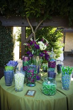 peacock themed candy buffet | Purple and green candy bar, great for peacock wedding theme..indeed