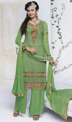 Induce refreshing vibes adorning this lime green shade chiffon embroidered churidar suit. This attire is effectively created with lace and resham work. #FabPistaGreenPakistaniDesignpalazzoSuit