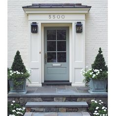 Front door in Farrow and Ball Blue Gray #91 - looks great with flagstone and slate. Lanterns from McLean Lighting.