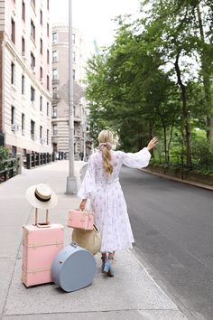 Dress: Emilia Wickstead (see more of my favorite summer floral dresses here). Hat Travel Case: Freya c/o (also love the mini bag here). Shoes: By Far. Hat: Gucci (see all my hat picks here). Suitcase...Read More