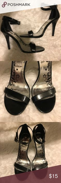 Black Strappy Heels Sandals Simple black heels with straps going across the ankle and toes, worn a few times. There is a tiny mark on the bottom of the left heel. Otherwise in great condition! Shoes Heels