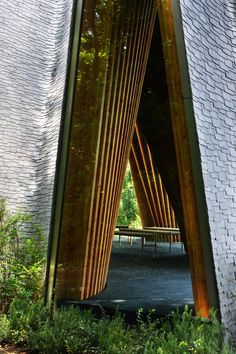 Sitting at the edge of the cemetery in Japan, Sayama Forest Chapel, designed by Hiroshi Nakamura & NAP, is shaped like two hands clasped in prayer. Biophilic Architecture, Architecture Design, Forest Resort, Timber Structure, Cabins And Cottages, Place Of Worship, Cemetery, Saitama Japan, Dalian