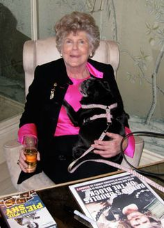 Brigid Berlin wit her pug. (Photo by Jeffrey Hirsch, New York Social Diary)-ultimate pug-lover and pug everything collector