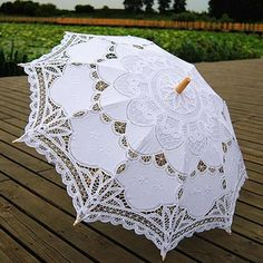 Product: Craft UmbrellaFunction: SlidingPanel Material: LaceSize: One SizePattern: Long-handle UmbrellaControl: Semi-automaticMaterial: Bamboo Note: Expect delivery in 2-6 weeks.  Material: cotton lace, wooden shaft and metal ribs Graceful edge and embroidered pure cotton lace parasol Size: approx. 30 (76cm) across