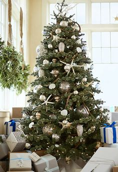 Deck the tree with starfish and mercury glass ornaments.