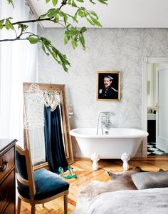 a Fashion Designer's Feminine and gorgeous bathroom with claw foot tub