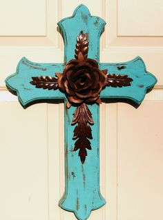 Bold turquoise stacked wooden cross accented with rustic tin rose and leaves.  Designed and hand-crafted by DiaMor De'cor     $85.00