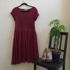 """Wine Colored Tea Length Dress Wine colored dress with lace on the bodice and relaxed flared skirt. 41"""" long. Bust 17"""". Waist 16.5"""". Mikarose Dresses"""