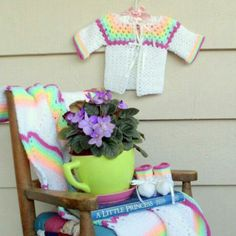 My shop is going on vacation! I'm off to visit the family farm. But before I go....here's my latest find! More treasures returning with me from America's Heartland!  Vintage Nursery Set Hand Knit Crocheted Sweater by Lachellybelly