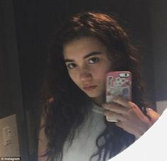 Being herself: A few hours after her photo caused a stir, Rowan posted this unsmiling self...