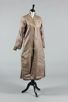 A lilac and silver brocaded lady's anteri robe, Ottoman, late 19th century, edged in silver braid, with scalloped neckline and cuffs