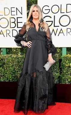 Tiziana Rocca from Worst Dressed at Golden Globes 2017  Tiziana Rocca donned a black, collared dress with sheer sleeves. It's a nice idea, this dress is simply too big. Between the sleeves and bottom, we're lost in all of the fabric.