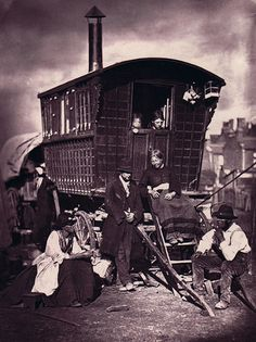 London Gypsies photographed by John Thomson in 1877 as part of a series entitled 'Street Life in London.' This photograph shows a friendly group gathered around a caravan belonging to one William Hampton. The woman seated on the steps, Mary Pradd, was murdered a few weeks after the photograph was taken.