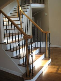 Photo of Concept Flooring - Woodstock, GA, United States. New Hardwood staircase and wrought iron balusters (spindles). Iron Stair Spindles, Wrought Iron Staircase, Iron Balusters, Staircase Railings, Staircase Design, Staircases, Banisters, Oak Stairs, House Stairs