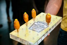 The catering tray for the mustard-topped corn dogs incorporated the label of Heinz's new yellow mustard.