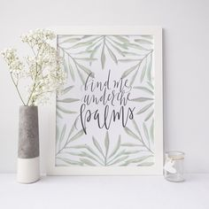 """Bring chic style to your home decor with this wall art print. It features the hand lettered phrase, """"find me under the palms."""""""