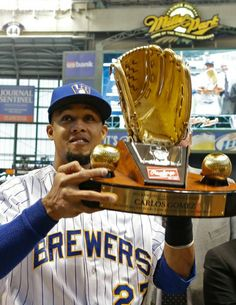 Carlos Gomez receives his Gold Glove Award at Miller Park prior to game two against the Pittsburgh Pirates (Saturday, April Cricket, Gold Gloves, Sports Fanatics, Baseball Photos, Blue Crew, Pittsburgh Pirates, National League, Milwaukee Brewers, Baseball Players
