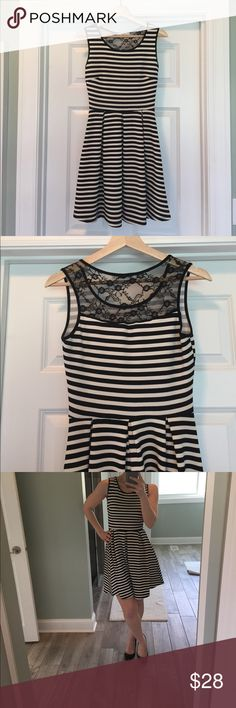 Le Lis sleeveless dress with lace detail XS sleeveless black and white striped dress with lace detail on back. Great condition super cute. Polyester/spandex machine washable. Le Lis Dresses Midi