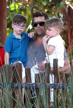 Singer Ricky Martin holds his sons, Matteo and Valentino.