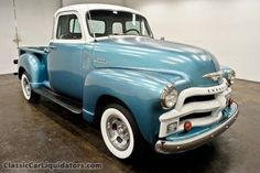 Metallic ice blue and white old pick up