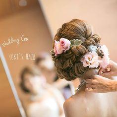 この画像は「最高のウエディングに華を添えて。貴女が主役の花嫁ヘアアレンジ15選」のまとめの12枚目の画像です。