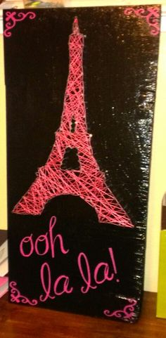 """First attempt at string art. I messed up a bit, but I am pretty happy with it. Used cricut to cut out Ma Sexy font """"ooh la la"""" on card stock, then stenciked, soonged the paint  Nod podge over everything but the eiffel tower."""