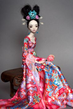 Beautiful doll with gorgeous dress! Protect this beauty inside a display case.