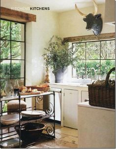 wrought iron open island in rustic French kitchen by Pamela Pierce, Atticmag, Western Interiors and Design I could do without the animal head over the window.why is that French Kitchen=ish? Modern Farmhouse Kitchens, Rustic Kitchen, Home Kitchens, Western Kitchen, Small Kitchens, Cottage Kitchens, Country Kitchens, Country Decor, Rustic Decor